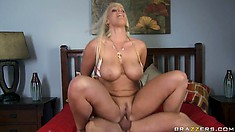 Pool boy lets a gorgeous busty blonde take a ride on top of his boner