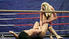 Backstage look at a pair of smoking hot bitches wrestling naked