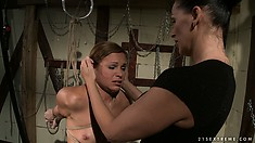 Mistress binds her slave and begins the fingering torture in the dungeon