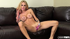Busty blonde Sarah Jessie poses, does a hot striptease and toys