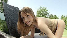 Attractive blonde Leyla Black allows the sun to kiss the perfect curves of her body