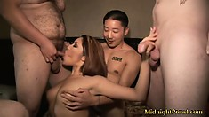 Asian ho gets her face stuffed and her tits groped in a gangbang