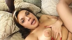 The sexy brunette lies on her back and the black stud fills her pussy with his shaft