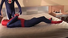 Sexy guy dressed as Spider-man gets down with another man in bed