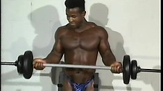 Black hunk lifts some weights and then drives his huge dick to orgasm