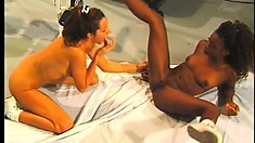 Lusty ebony lesbian enjoys plowing her girl's moist slit with a strap-on