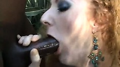Curly red-head Annie Body is ass-banged by long black weapon
