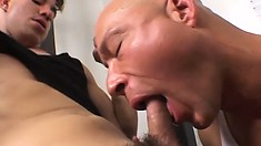 Hot bald headed stud blows a big cock and receives it up his butt hole