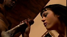 Goth in high boots drools all over a black dick on the couch
