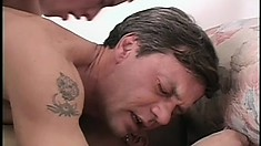 Hot gay stud welcomes two stiff cocks deep in his anal hole at the same time