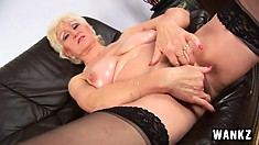 Big titty granny Janka plays with her boobs and then her wet slit