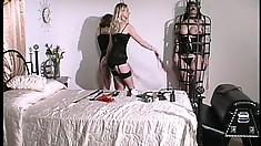 Evil seductress in black dress Erzsbet wants to spank her sex slave