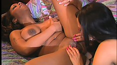 Buxom ebony beauties savor the delicious taste of each other's pussies