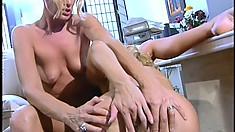 Naughty blonde secretaries indulge in lesbian sex during a lunch break
