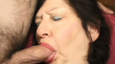 Mature lady with huge tits invites two young guys to fulfill her needs