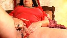 Nasty old brunette granny fingers her plumper, pierced pussy