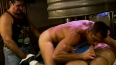 Muscled studs engage in a hardcore gay threesome on the pool table