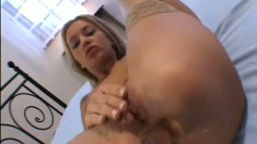 Long-haired babe likes sucking glass dildo and then sticking it in her ass