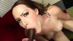 Desirable redhead relinquishes her fiery pussy to a massive black cock