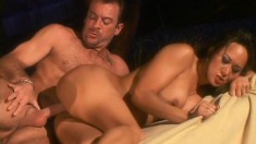 A slim woman with big tits sits her tight butt down on a hard cock