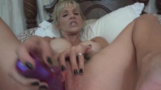 Busty blonde wife Emy Banx plays with sex toys and blows a fact cock
