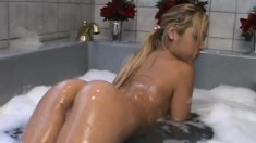 Blonde Asian is playing around in her bathtub and getting washed up