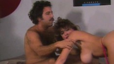 Buxom Christy Canyon rides Ron Jeremy's shaft with elegance and desire