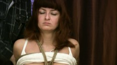 Skinny brunette slave is tied up by her master on her stomach