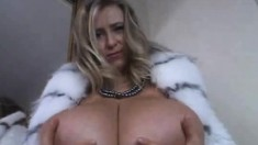 Sexy blonde milf sensually exposes her massive hooters for the camera