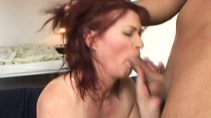 Slutty redheaded chick strokes her tits while bouncing on a cock