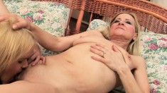 Mature and young lesbians fulfill their desires with a strap-on dildo