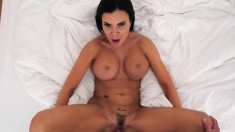 Big-breasted brunette gets down on her knees to suck on a fat dick