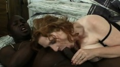 Busty redheaded broad bends over to feel this black dong up her bunghole