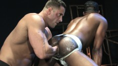 Interracial gay partners take turns roughly fisting each other's asses