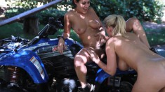 Blonde and brunette hotties indulging in wild lesbian action outside
