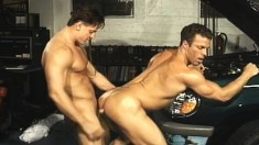 Hunky mechanics Scott Randsome and Jake Andrews engage in anal action