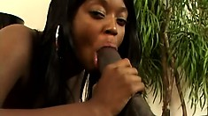 Cute black babe with big natural tits Roxie Ray sticks a huge black cock in her mouth