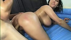 Wild brunette gets her huge knockers oiled and fucked by a toned guy