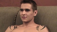 Stud with sexy tattoos strokes on his hairy cock until he cums