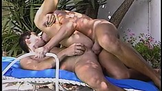 Two lusty cocksuckers take turns sucking and fucking each other poolside