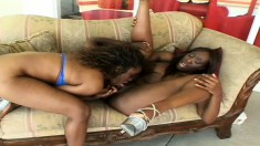 These hard-bodied black babes satisfy each other's sexual desires