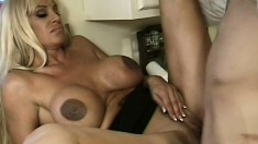 Buxom blonde cougar Kat Kleevage sucks and fucks a young stud's cock