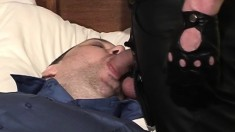Businessman gets a visit from a scary dude in leathers and sucks his dick