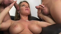 Big breasted blonde milf has two hung studs drilling her fiery holes