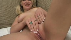 Buxom young blonde with pigtails makes the most of her time with two black dicks