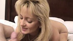 Exciting blonde cougar surrenders her needy snatch to a long stick