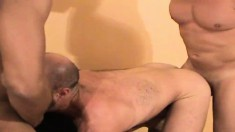 Lustful gay man has two studs fucking his ass just like he desires