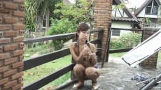 Adorable Asian girl Ammy displays her sexy slim body in the outdoors