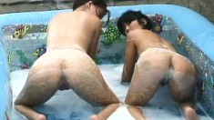 Sweet Oriental girl Cindy Lee indulges in wild lesbian sex in the pool