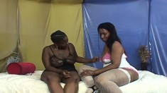 Ebony lesbian plumpers use a vibrator in between eating their pussies